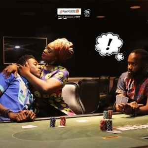 #BBNaija: Evicted Housemate Soma Pictured Resting His Head On Uriel's Chest As Noble Igwe Stares In New Payporte Promo Photos